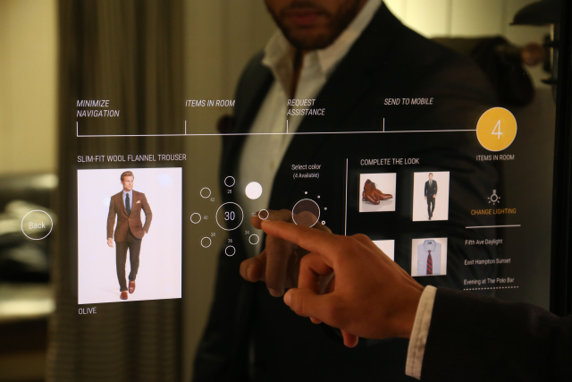 A Polo Ralph Lauren associate trying out the interactive fitting room.